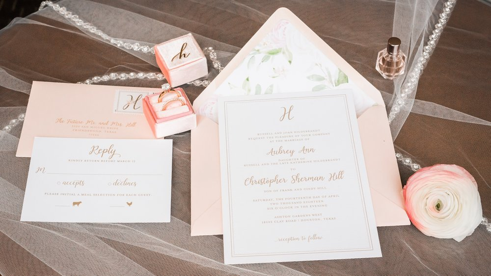 Blush invitation suite with floral accents, and a Monogram