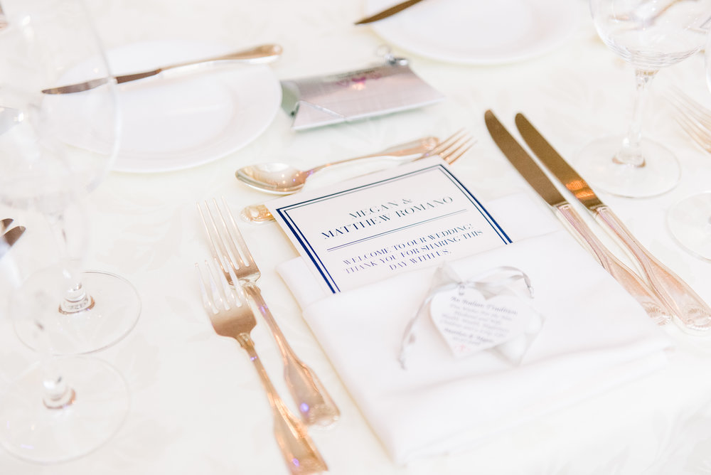 Wedding table setup, blue and white menu card with a napkin in a menu fold