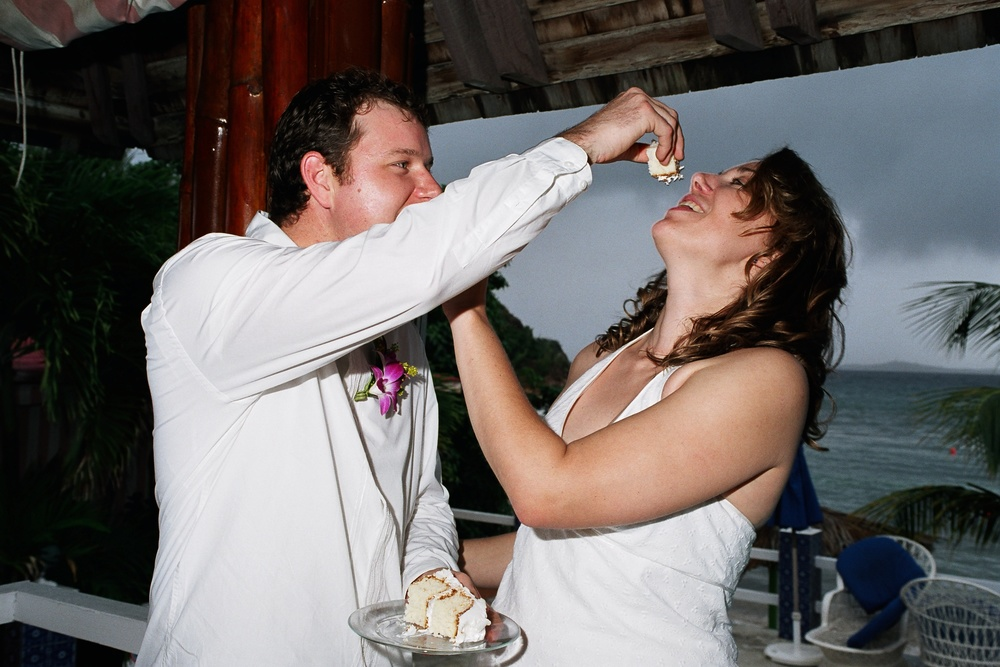 Me being force-fed my own wedding cake almost 11 years ago