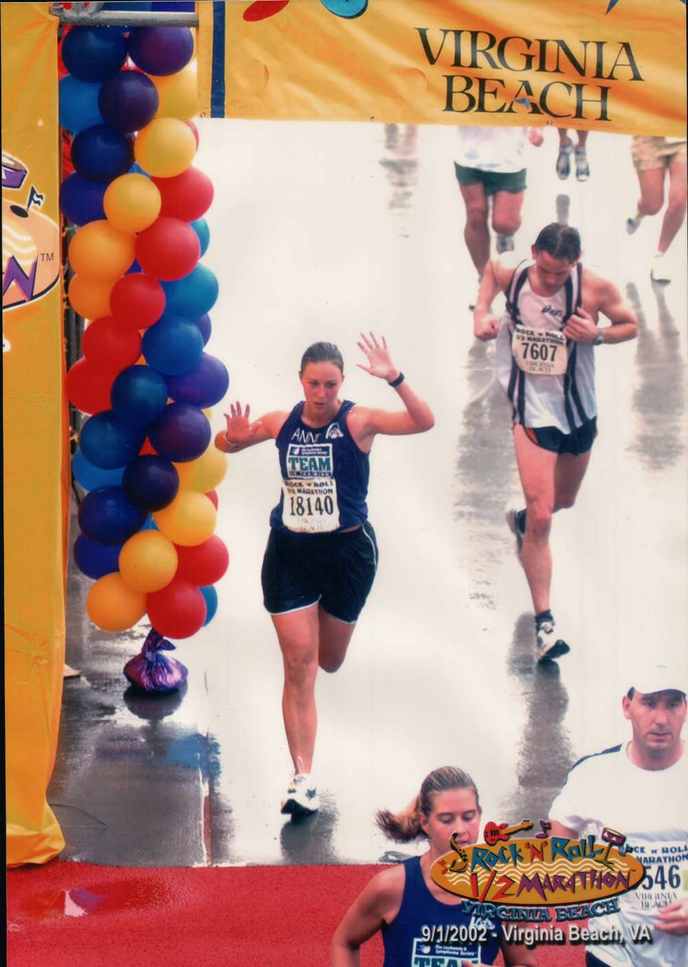 Crossing the finish line at my first half-marathon ever! Virginia Beach, September 2002