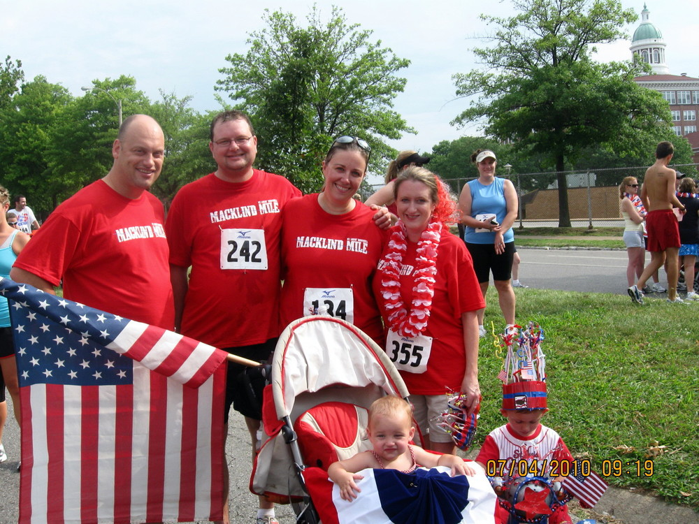 Me and Eric with our friends John and Maddisson, and their kids,  back in 2010, doing the Macklind Mile.