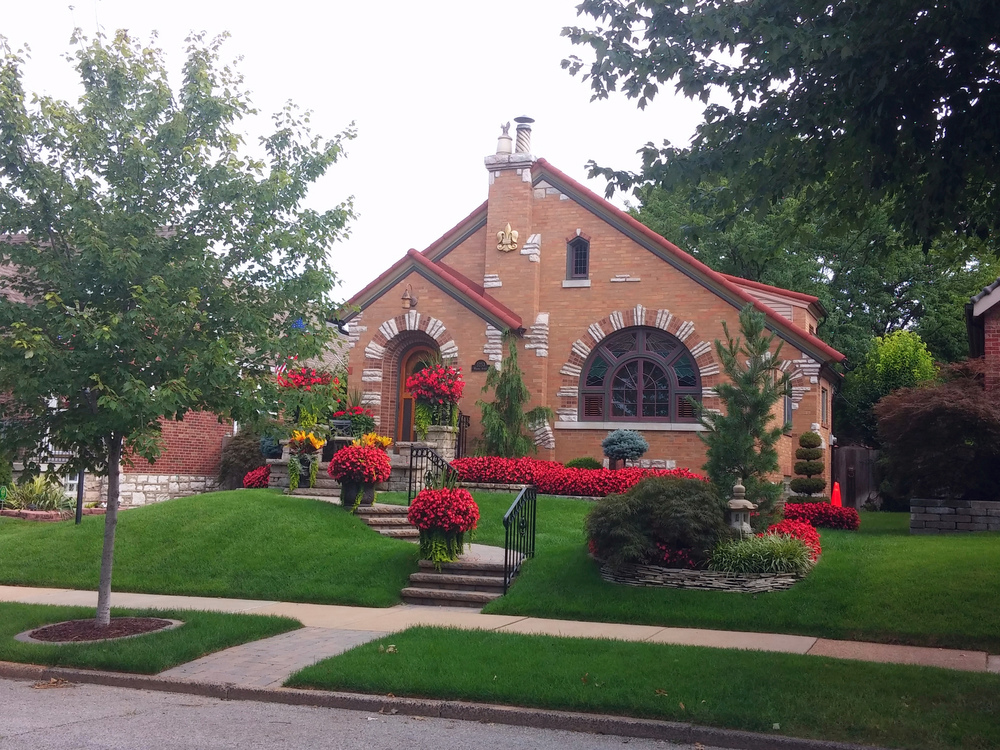 And the Most Awesome-est Landscaping Award goes to... This house always makes me smile.