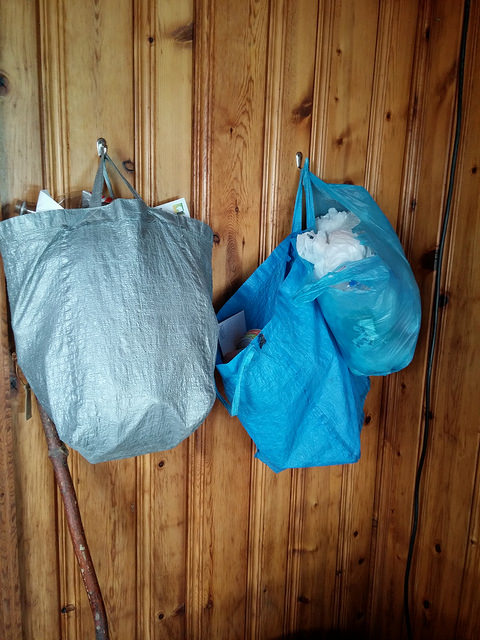 Recycling center with embarrassingly large bag of plastic bags on the right.