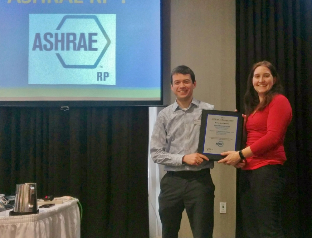 Aaron Smith being presented with the 2015 ASHRAE Technology Award by Chapter Technology Transfer Chair (CTTC) Laura Whynacht.
