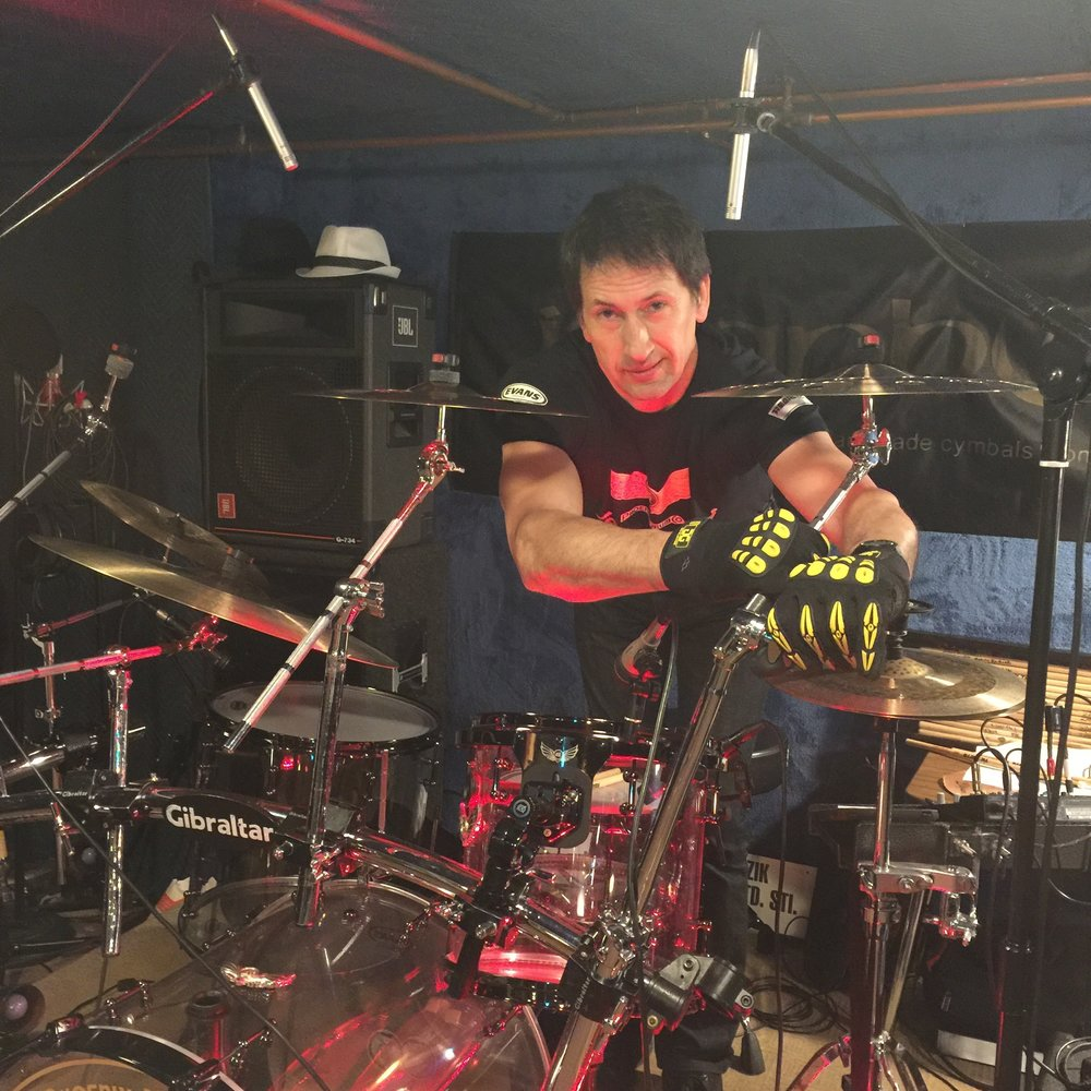 Claudio Galinski setting up his kit wearing Gig Gloves