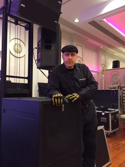 Stas Olshansky of Solvetech Productions wearing his Original Gig Gloves on the job in Brooklyn, NY.