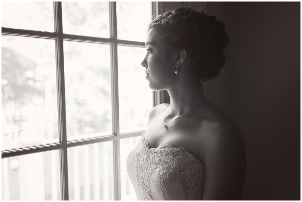 Bride at window, Richmond VA Wedding Photographer