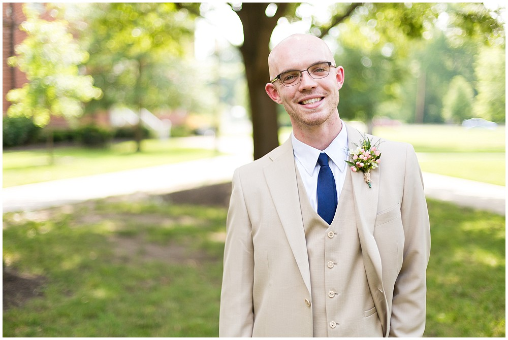groom pink boutonniere