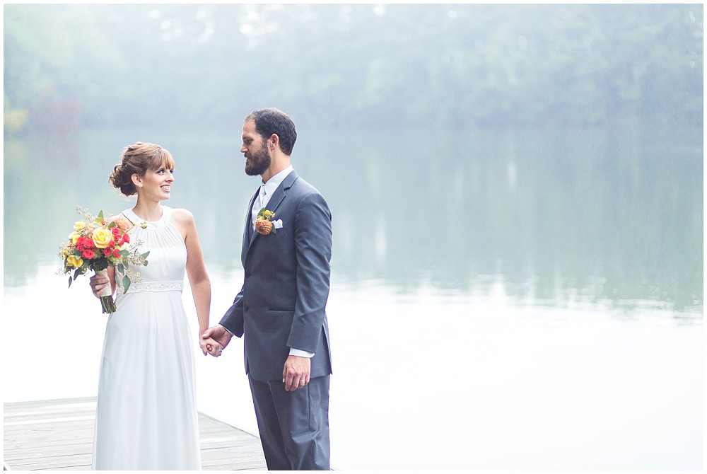 sandy bottom nature park wedding bride and groom on the dock