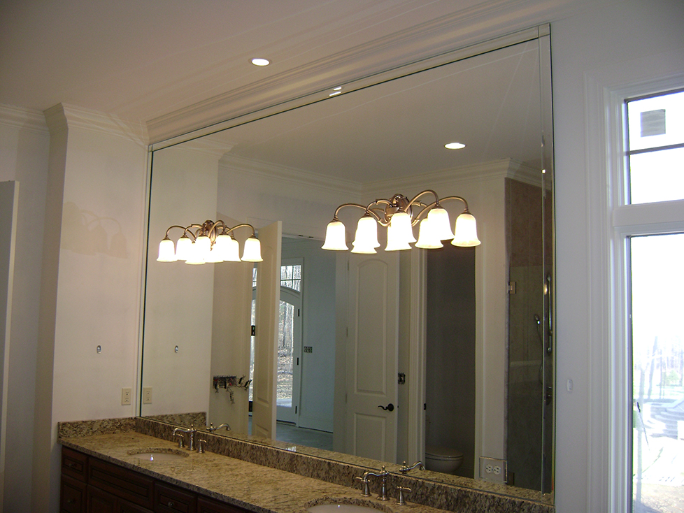 Vanity Mirror with Fabrication for Light Fixtures and Custom Bevel Strip Overlay