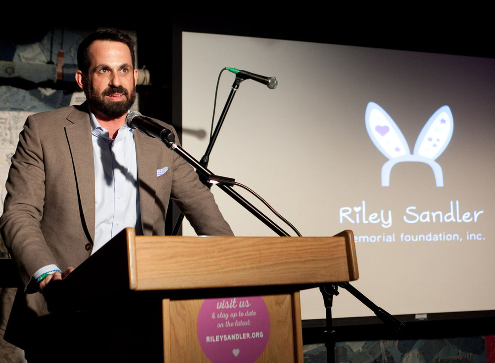 Ian Sandler speaks at the Riley Sandler Memorial Foundation fundraiser in the basement of Hill Country Barbecue Market in New York. Source: Angel Vasquez via Bloomberg