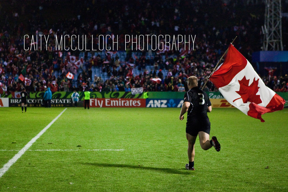 So proud to be Canadian. Jason Marshall takes the flag for a spin after we won the game against Tonga.