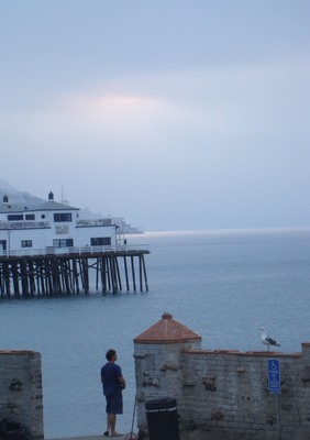 Sunrise-not at the Malibu Pier as onlookers look on.