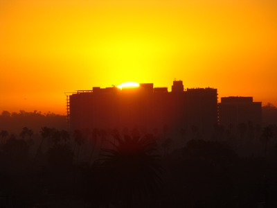 Sunrise leaps up  from behind the big building in Marina del Rey from Santa Monica. There are only two ways to live your life. One as though nothing is a miracle. The other is as though everything is a miracle.   …. Albert Einstein