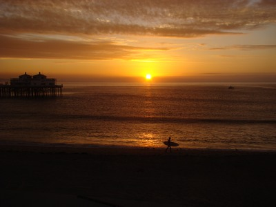 Sunrise as a surfer rushes to the surf. Things change. People come and people go. Our paths always call us to our greater-yet-to-be. Grateful for life's miraculous intersections. Common sense is the collection of prejudices acquired by age eighteen. …Albert Einstein