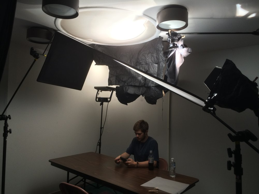 ... so much of the film with a book light setup that we felt we had to continue that look to be consistent so we designed a book light on the ceiling. & The Cinematography of