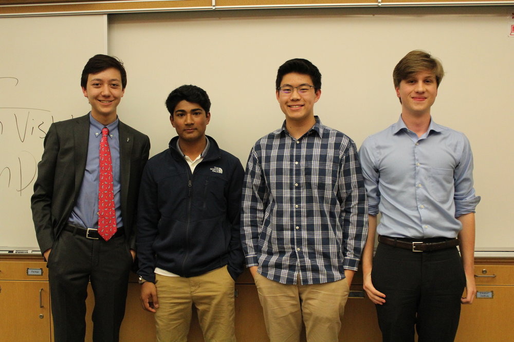 (from left) Kai Burgmann, Krish Visht, Kevin Deng, and Cole McCann-Phillips pose after debating in the final round.