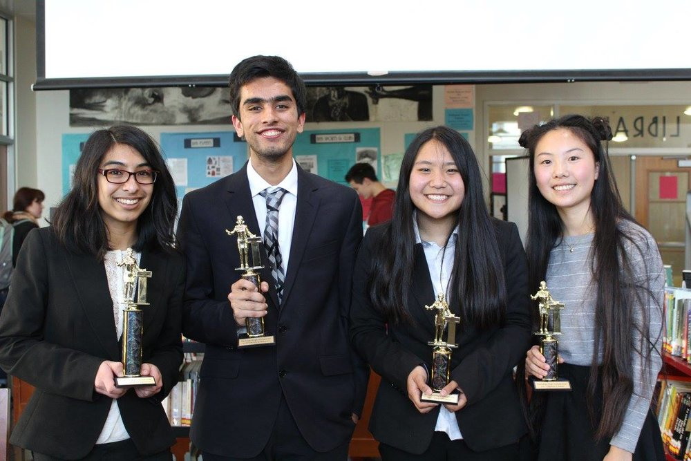 Bhattarcharya, Pombra, Jia, and Jiang pose with trophies after the final round. (Left to right)