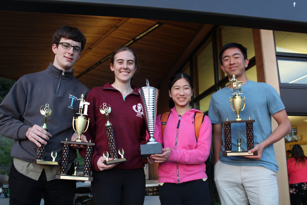 (left to right) Dembner, Hackworth, Cheng, and Lee pose with speaker and semifinal trophies in addition to the California Cup