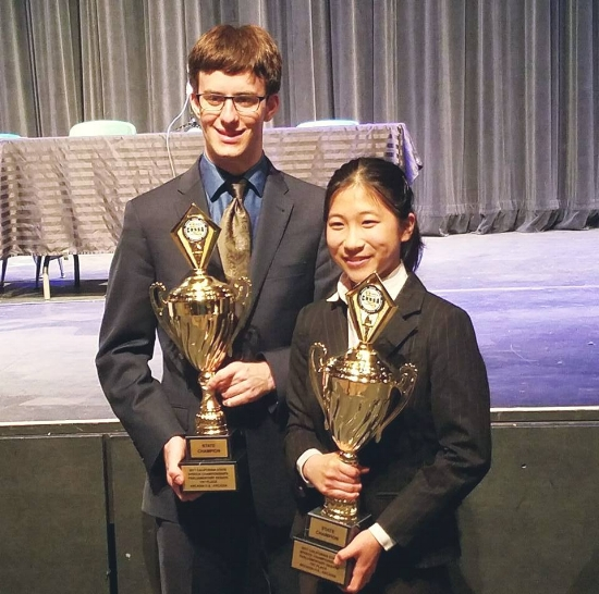 Spencer Dembner & Shirley Cheng pose with championship trophies. Image courtesy of Julie Herman.
