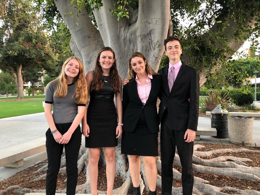 Left to right: Alden O'Rafferty, Claudia Hester, Sienna Horvath, and Jackson Paluck pose before finals.