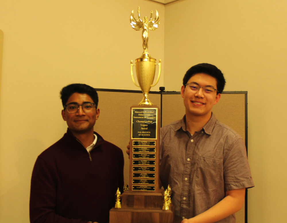 Visht & Deng pose with new TOC legacy award after oral decisions from judges.