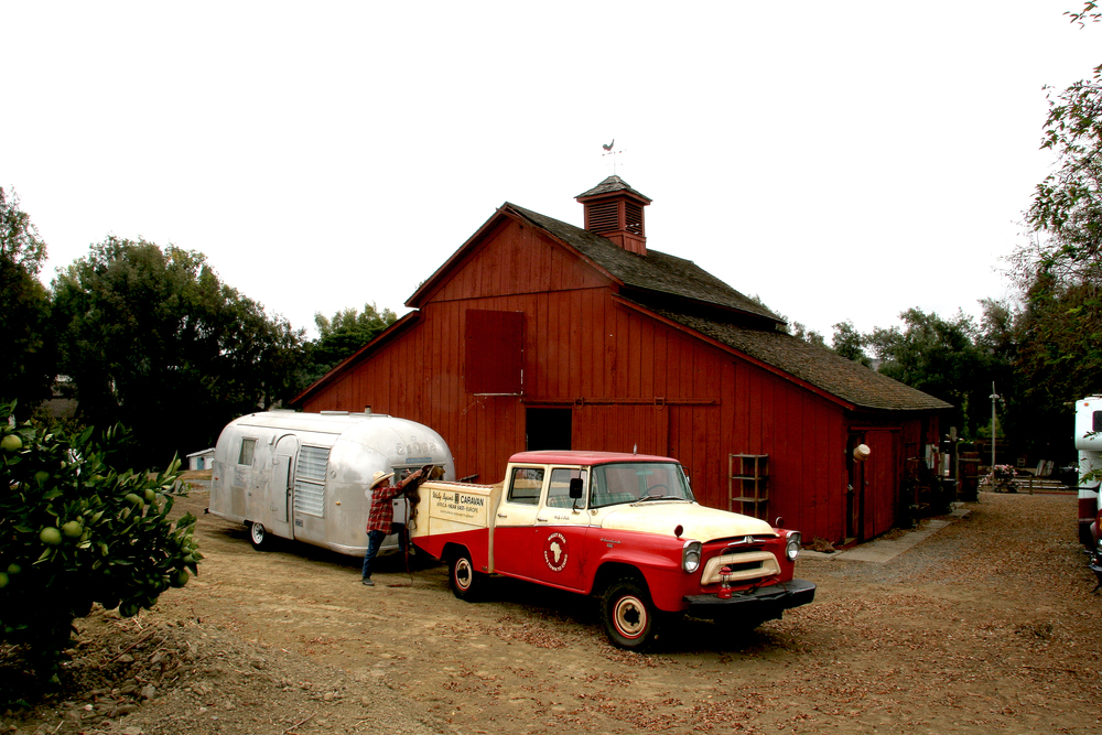 Image by Larry Saavedra. Photograph of International Harvester in front of the 100 year-old Cook Barn in San Juan Capistrano, CA.