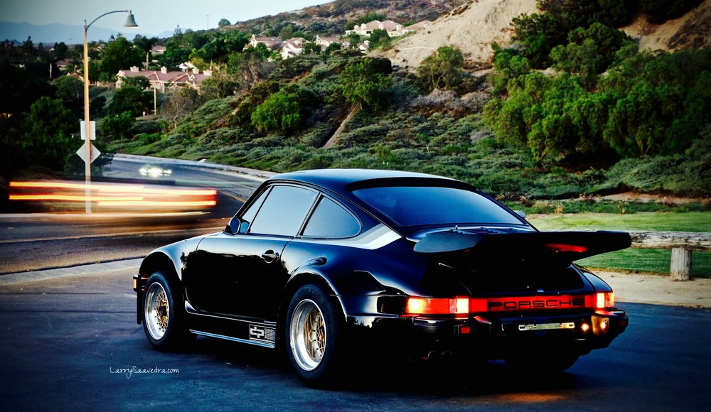 Porsche Kremer 935 at night with street lights and long exposure.