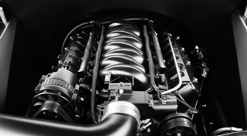 '57 Chevy custom V8 engine photographed with natural light outdoors.