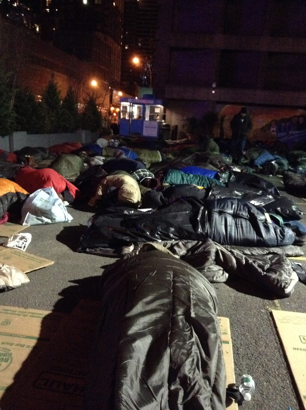 Business execs sleeping out in a NYC Parking lot - surreal!