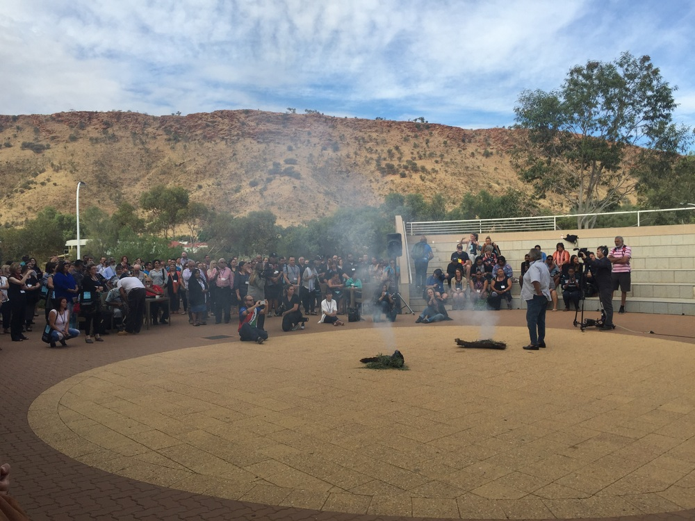 Smoking ceremony at the foot of the caterpillar mountains which are part of the story of Alice Springs & Arrente people