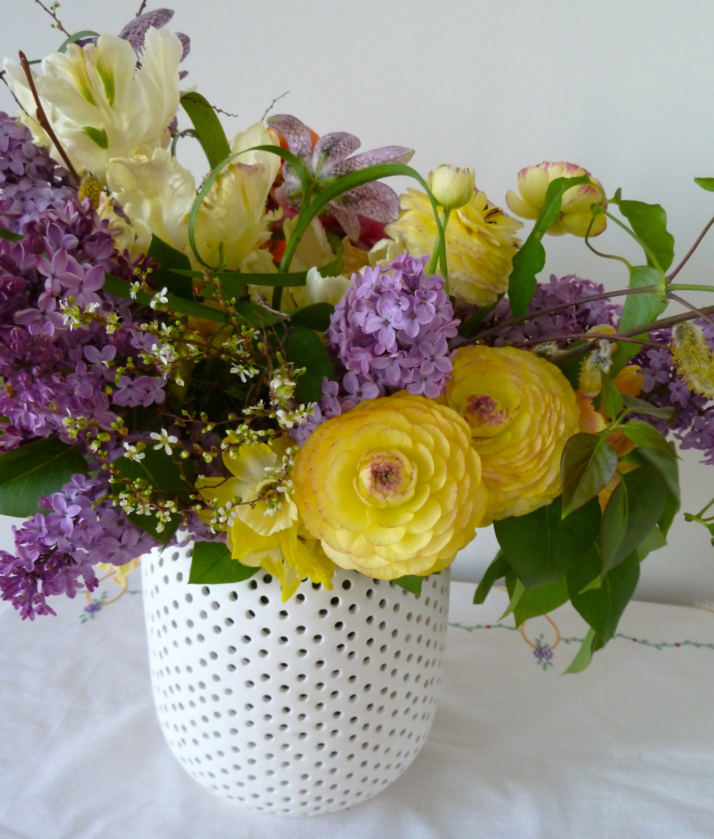 Lilac, little daffodils and even the spiraea used in this arrangement all smell delicious and scream spring but rarely last a week once cut