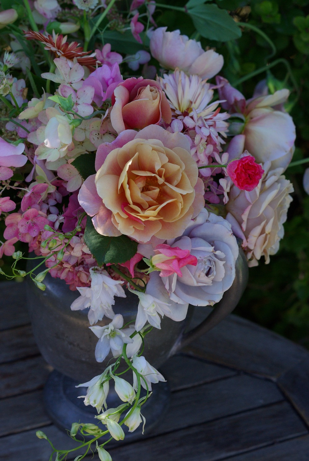Early September - delphinium, hydrangea, roses, sweet peas, shirley poppies, calendula, astrantia