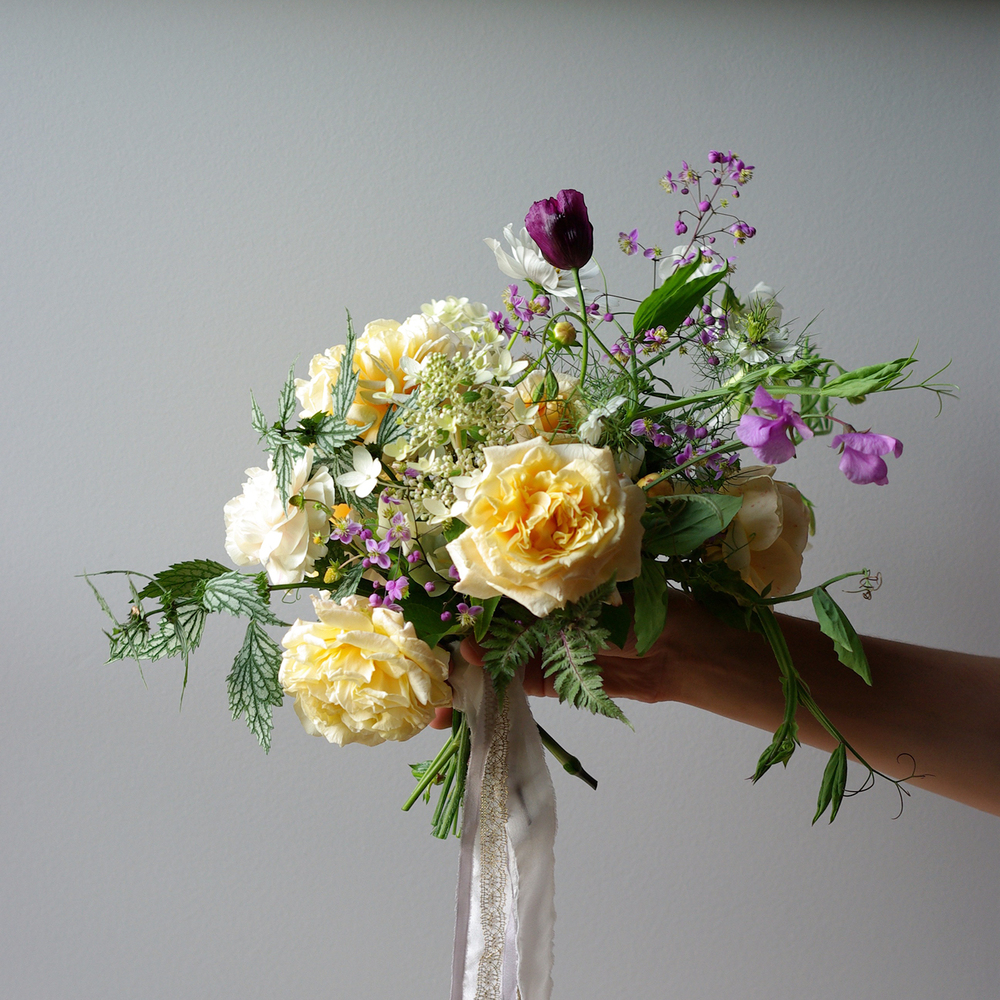 A bouquet with 'Carmella Fairy Tale' and 'Graham Thomas'