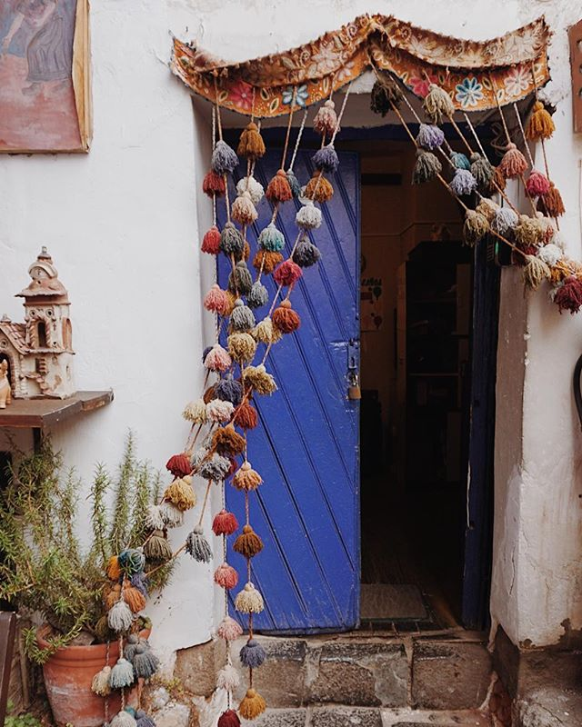 "I have this thing with tassels. Who's with me? 🙋🏿‍♀️🙋🏻‍♀️🙋🏼‍♀️🙋🏽‍♀️🙋🏾‍♀️ Also this door color is 👌🏼 My husband dubbed it ""blurple"" and I'm totally on board with that. #Peru"