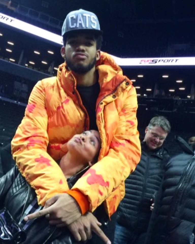 Karl-Anthony Towns took a break from the traditional green colorway after the 'Timberwolves vs. Nets'game in a neon orange camo printed puffer.