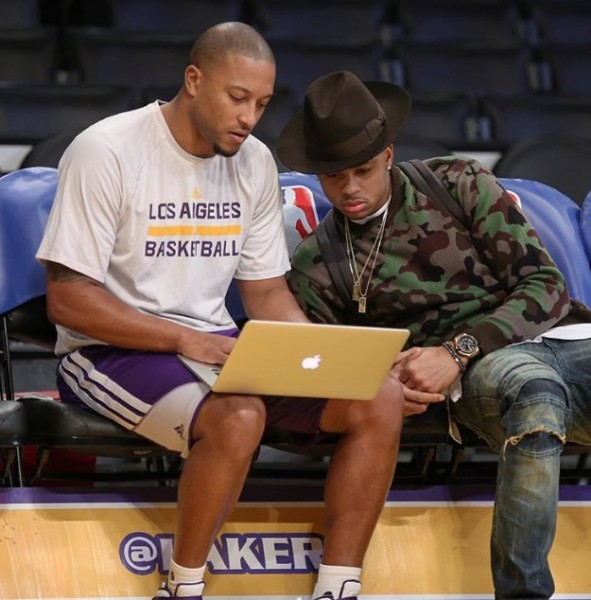 D'Angelo Russellrocked a more traditional palette with a coordinating brown fedora and distressed denim.