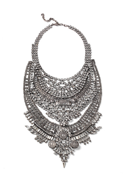 "You've seen all the cool girls rock it (Rihanna, Gigi, Gaga, etc) but now you need to learn the name! DYLANLEX- makers of the ultimate chunky sparkly necklace. One minute on their site and you'll see why everyone is wearing them. A standout to me is the ""Falkor"" necklace which retails for $980.00 here."