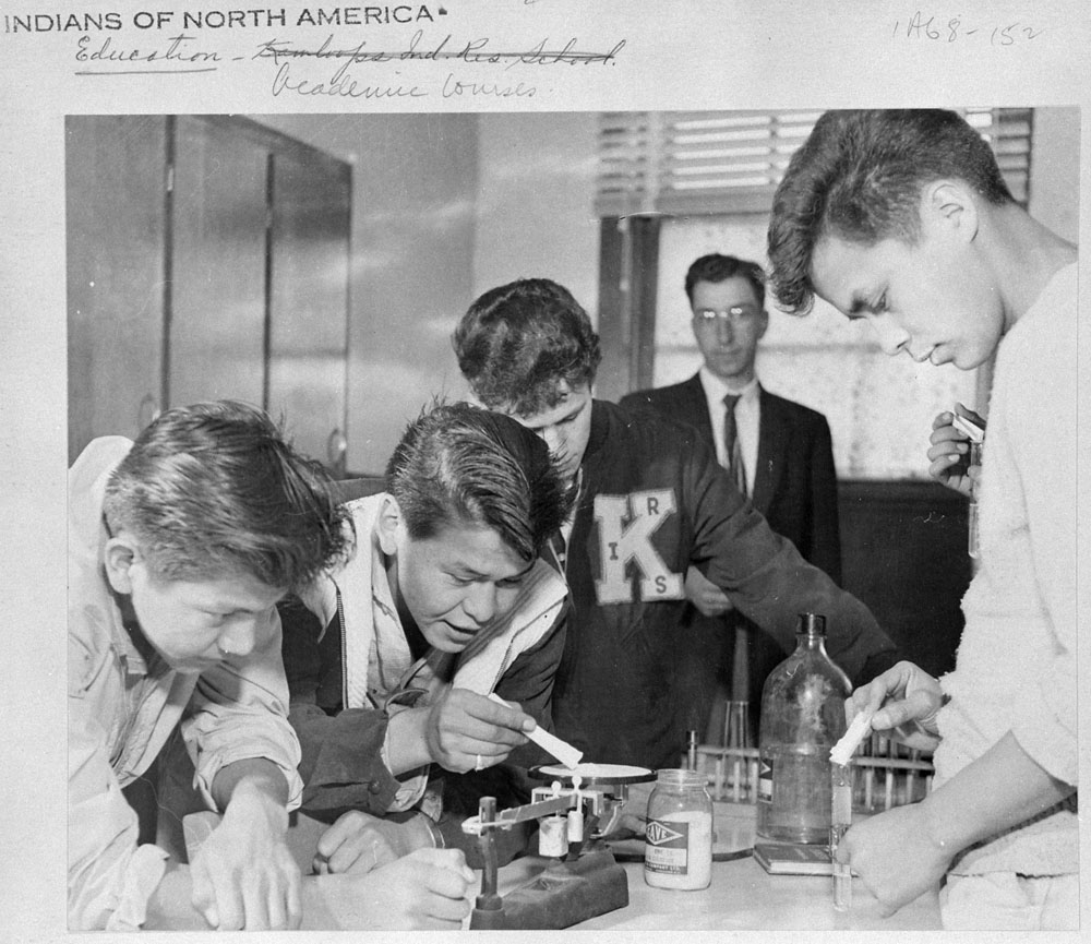 Basil Fox, Photographer.  Chemistry Class Kamloops Indian Residential School, British Columbia, ca. 1959 . From: Canadian Government Archives: Residential Schools: Photographic Collections, c. 1959.