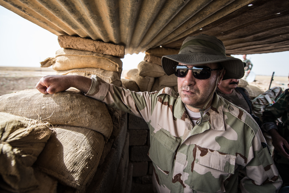 A peshmerga General in a fortified trench position.