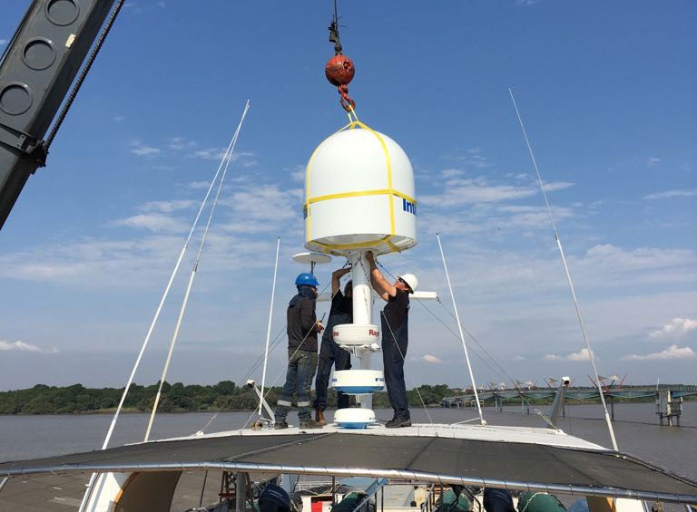 The new satellite antenna is being hoisted into place