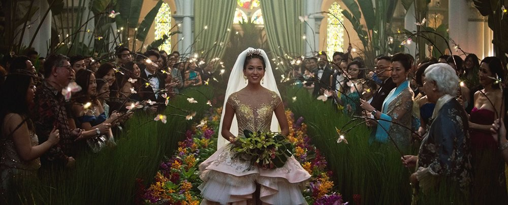 "This doesn't necessarily register to me as an ""Asian wedding"" ...unless it's in an ""Asian movie.""  But it  is  an over-the-top wedding, which is just Hollywood being itself."