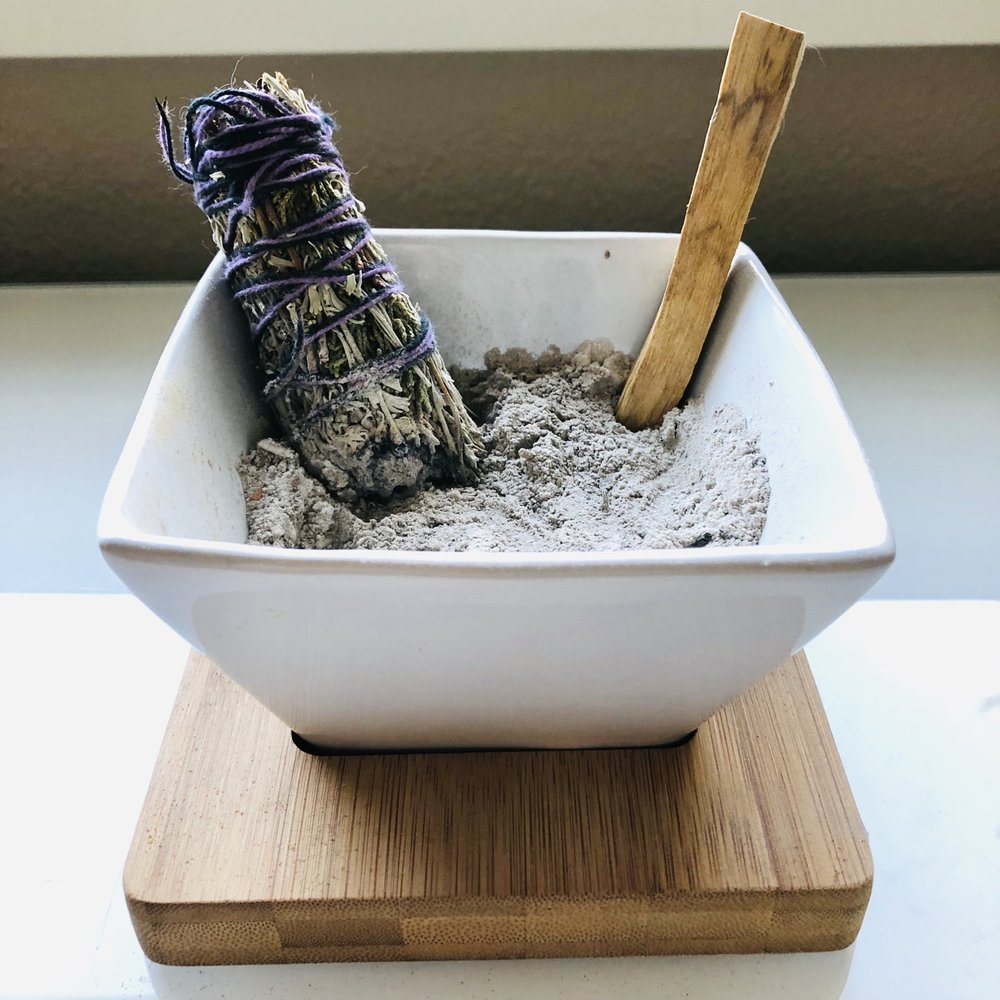 white sage bundle with a stick of palo santo