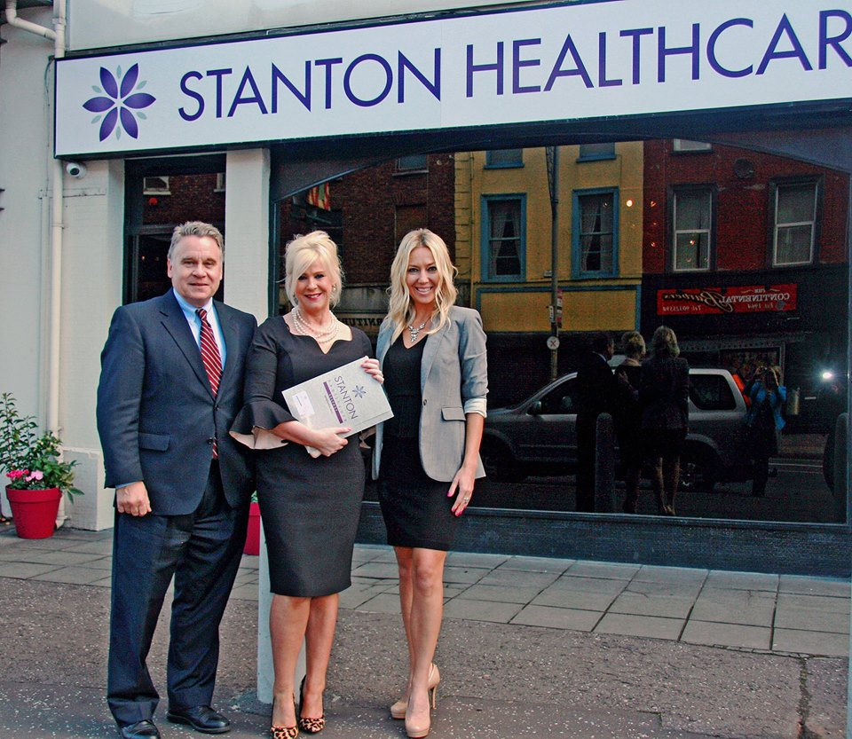 Rep. Chris Smith, Bernie Smyth and Brandi Swindell (l-r) outside Stanton Healthcare on Greater Victoria Street.