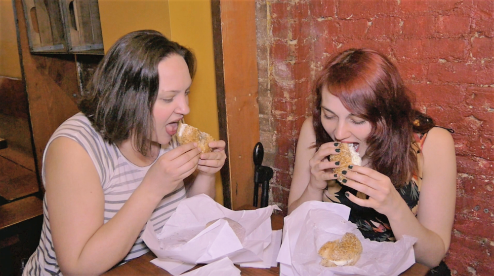 Adrienne and Laura chowing down on some  Tompkins Square Bagels . Photo Credit:  Culture Clock
