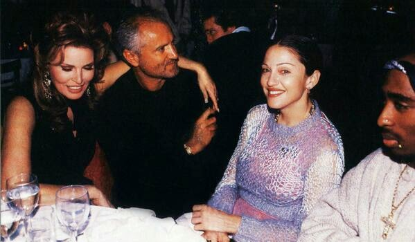 2pac sitting at table with designer Gianni Versace & Madonna