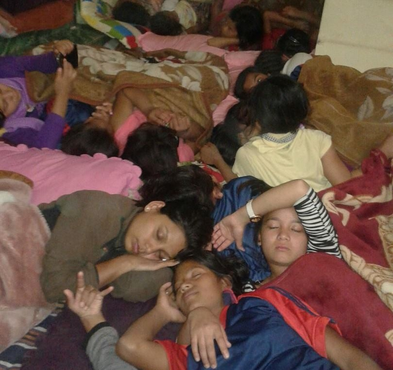 Children sleep at Asha Nepal's office.