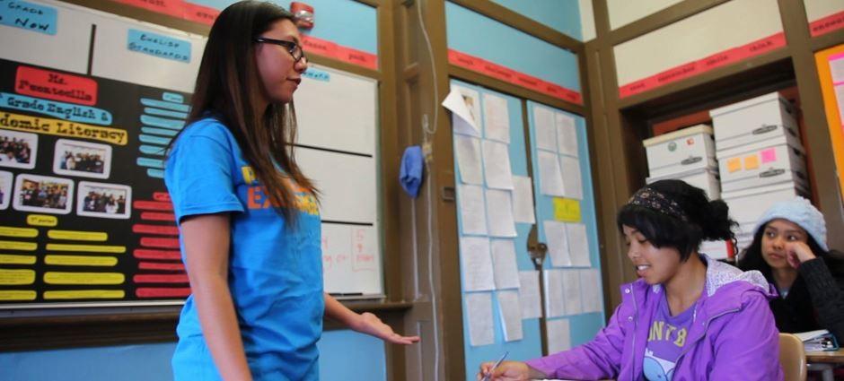 Peer Health Exchange Volunteer teaching a class to High School students.