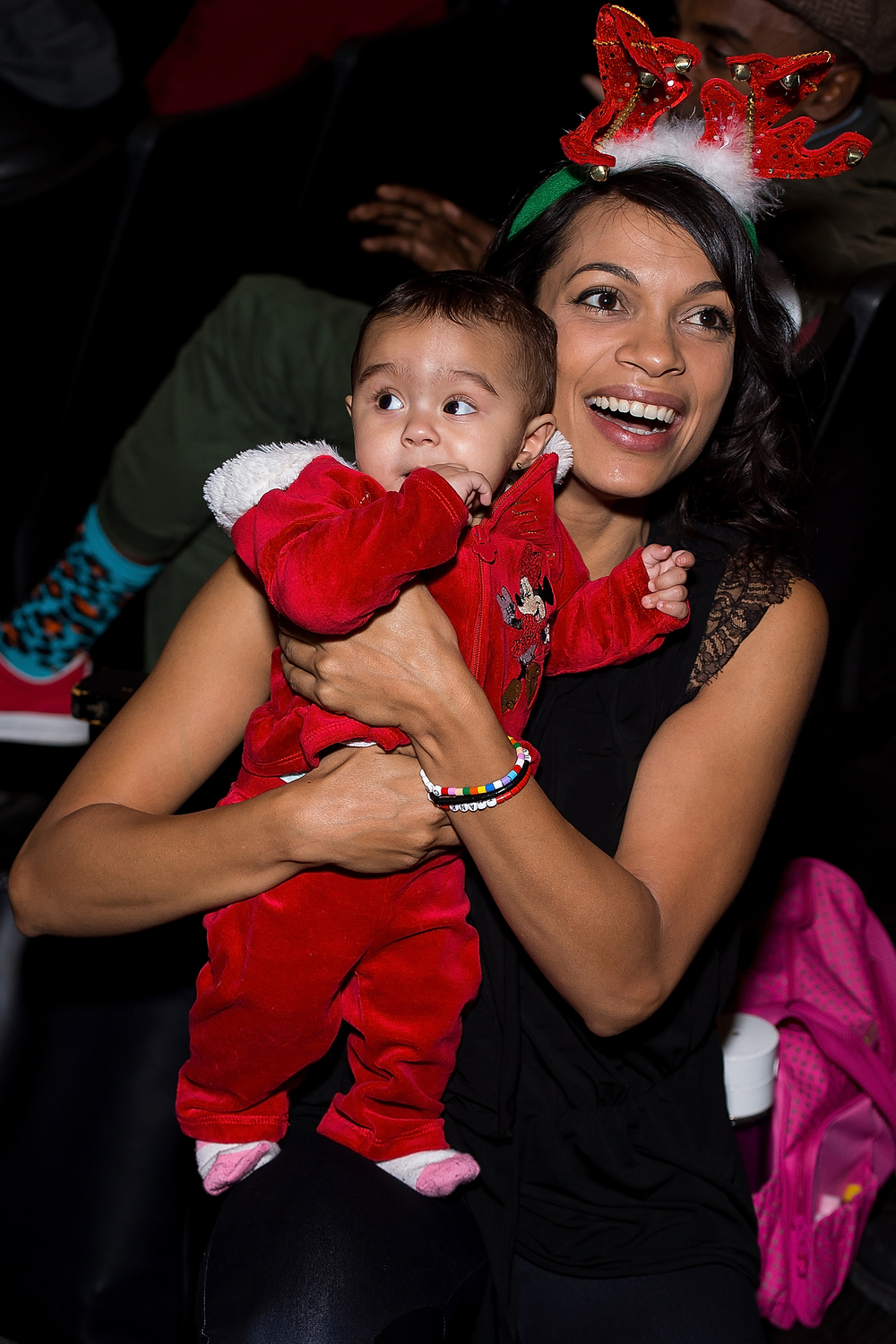 Taken moments before she joined Childhood USA's #EyesWideOpen on stage, Actress Rosario Dawson met one of her newest fans during the West Harlem Community Holiday Celebration and Toy Giveaway.