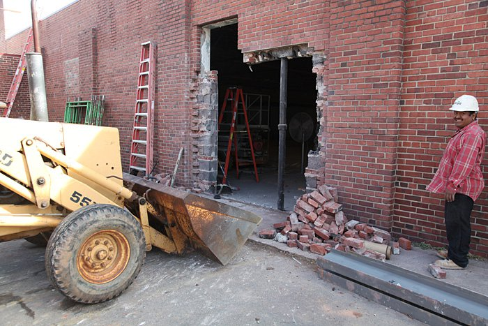 As part of the renovation process, the entrance for Company Shops was moved from Front Street to the parking lot side of the building. This hole in the wall eventually became the primary entrance into the store.